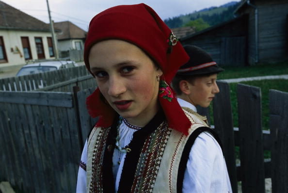 A girl and boy dressed in Csango traditional colors